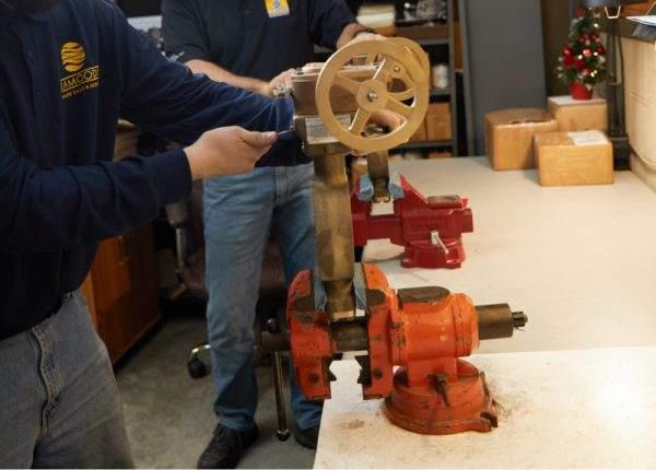 Technician working on valve